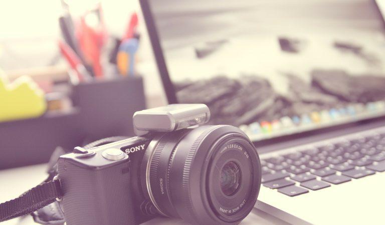camera next to laptop